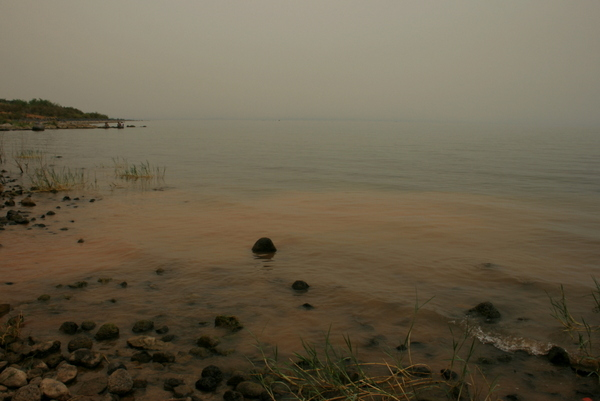 The Sea of Galilee, on a misty but very hot day in 2010. The sea was very calm.